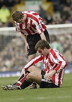 Photo: Aidan Ellis.<br /> Everton v Sunderland. The Barclays Premiership. 01/04/2006.<br /> Sunderland'sChris Brown suffers a head injury as team mate george mcArtney tends to him