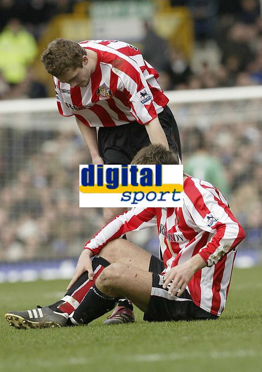 Photo: Aidan Ellis.<br /> Everton v Sunderland. The Barclays Premiership. 01/04/2006.<br /> Sunderland'sChris Brown suffers a head injury as team mate george mcArtney tends to him