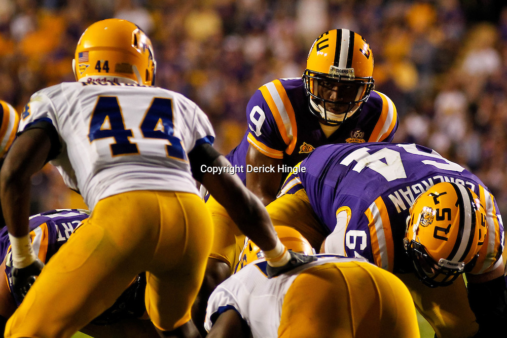 October 16, 2010; Baton Rouge, LA, USA; LSU Tigers quarterback Jordan Jefferson (9) under center during a game against the McNeese State Cowboys at Tiger Stadium. LSU defeated McNeese State 32-10. Mandatory Credit: Derick E. Hingle