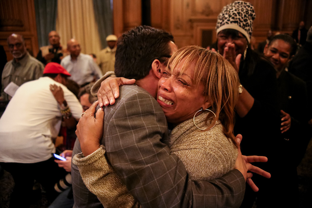 Gwendolyn Woods, mother of Mario Woods, embraces San Francisco District 9 Supervisor David Campos after the San Francisco Board of Supervisors unanimously voted to approve Mario Woods Remembrance Day to be held on July 22nd, Mario Woods' birthday, in the city and county of San Francisco, Calif., Tuesday, January 26, 2016.<br /> <br /> The Police Officers Association (POA) sent Board President London Breed a letter insisting that the city should honor officers killed in the line of duty instead of Mario Woods following the board's unanimous vote. A week prior to the vote, an estimated 100 members of the POA showed up during a San Francisco Police Commission meeting to support the five officers who fatally shot Woods in December 2015.