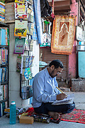 Mohammed Ghalib, a katib - traditional calligrapher - in Urdu Bazaar, Old Delhi, India. Ghalib is now the last traditional calligrapher still practising his art. Urdu fonts are now largely computerised and work is almost non-existant comprising of the odd wedding invitation and re-drawing old legal documents.