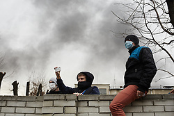 © Licensed to London News Pictures. 19/02/2014. Ukraine, Onlookers during protests in Kalush, western Ukraine, when Security Service of Ukraine and Party of Regions buildings were attacked. Photo credit : Christopher Nunn/LNP