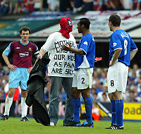 Photo. Chris Ratcliffe, Digitalsport<br /> NORWAY ONLY<br /> <br /> Ipswich Town v West Ham United. Division One Play-off Semi-final. 15/05/2004<br /> A Spiderman pitch invader with the slogan 'Mothers who use their kids as pawns are sick' confronts Fabian Wilnis of ipswich as he tries to show him off the pitch