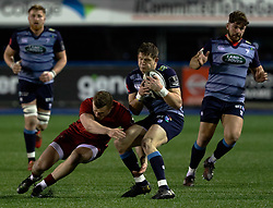 Cardiff Blues' Lloyd Williams takes the high ball despite pressure from Munster's Stephen Fitzgerald<br /> <br /> Photographer Simon King/Replay Images<br /> <br /> Guinness PRO14 Round 15 - Cardiff Blues v Munster - Saturday 17th February 2018 - Cardiff Arms Park - Cardiff<br /> <br /> World Copyright © Replay Images . All rights reserved. info@replayimages.co.uk - http://replayimages.co.uk