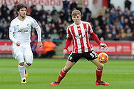 Southampton's Matt Targett (r) controls the ball watched by Swansea's Alberto Paloschi. Barclays Premier league match, Swansea city v Southampton at the Liberty Stadium in Swansea, South Wales on Saturday 13th February 2016.<br /> pic by  Carl Robertson, Andrew Orchard sports photography.