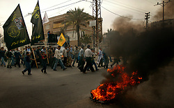 Palestinians burn tires in the streets after the news of Yasser Arafat's death spread, Gaza, Palestinian Territories, Nov. 11, 2004. Arafat died in a Paris hospital at the age of 75.