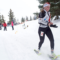 Second place women's soloist Tess Amer pulls on her gloves as she embarks on the snowshoe leg of the Mount Taylor Winter Quadrathlon in Grants Saturday.
