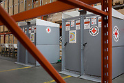Latrines in emergency supplies warehouse, Deutsches Rotes Kreuz (DRK - German Red Cross) at their logistics centre at Berlin-Schönefeld airport. Ready for immediate loading into disaster zones, the equipment is stored near to where freight aircraft can fly anywhere in the world. The International Red Cross and Red Crescent Movement, with its 187 National Societies, is the world's largest humanitarian network. The German Red Cross is part of this universal community, which started 150 years ago to deliver comprehensive aid to people affected by conflict, disaster, sanitary emergencies, or social hardship, guided solely by their needs. Around four million volunteers and members support the Red Cross in Germany alone.