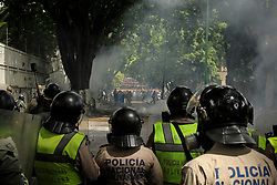 A group of protesters clash with police during a protest by opponents of the Venezuelan government in Caracas, Venezuela, 1 May 2017.