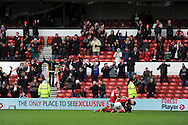 Home supporters go crazy as Nottingham Forests Jamie Paterson (on ground) celebrates scoring his sides 4th goal  FA Cup with Budweiser, 3rd round, Nottingham Forest v West Ham Utd match at the City Ground in Nottingham, England on Sunday 5th Jan 2014.<br /> pic by Andrew Orchard, Andrew Orchard sports photography.