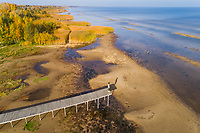 Aerial view of man standing on the edge of wood pier, Estonia.