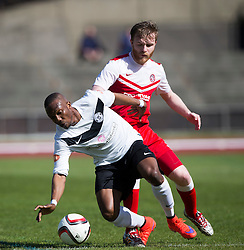 Edinburgh City's Ortega Deniran and Brora Rangers Dale Gillespie. <br /> half time : Edinburgh City 0 v 0 Brora Rangers, 1st leg, Pyramid Playoffs at Meadowbank, 25/4/2015.