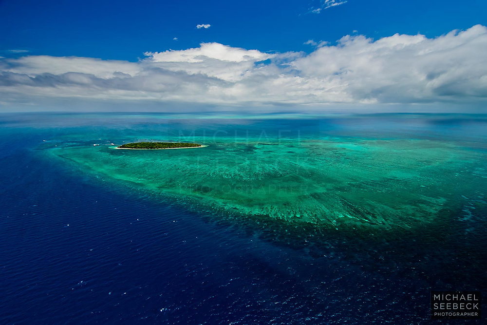 An aerial photograph of Green Island and its coral reef. Green Island is situated offshore from Cairns in Far North Queensland.<br /> <br /> Open Edition Print / Stock Image