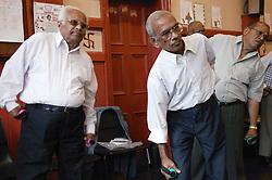 Group of elderly men taking part in exercise class,