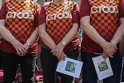 © Licensed to London News Pictures. 11/05/2017. Bradford, UK. A ceremony is held in Bradford to commemorate the 32nd anniversary of the Bradford City fire. The Bradford City fire happened on 11th May 1985 during a game between Bradford City and Lincoln City. The disaster killed 56 and injured at least 265 people. Photo credit : Ian Hinchliffe/LNP