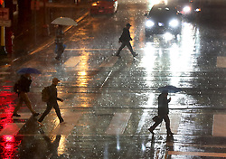 October 3, 2017 - Minneapolis, MN, US - It was a soggy commute for those downtown near 6th St. S and 2nd Ave. Tuesday, Oct. 3, 2017, in Minneapolis, MN.]........DAVID JOLES • david.joles@startribune.com....Heavy overnight rains, followed by strong morning showers saturated the ground in the metro and parts of the state. (Credit Image: © David Joles/Minneapolis Star Tribune via ZUMA Wire)