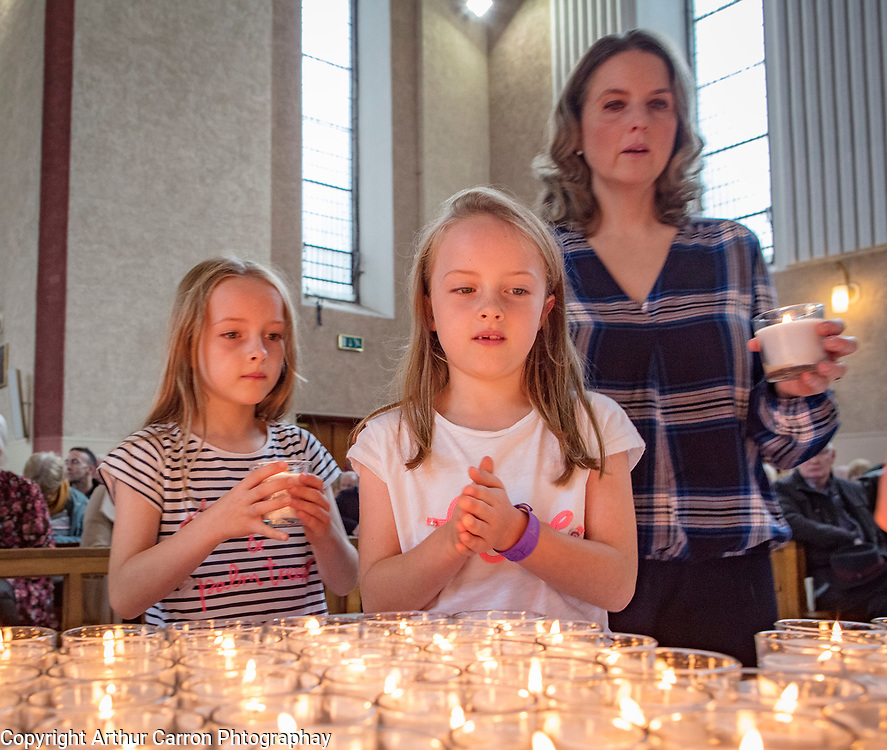 NO FEE PICTURES                                                                                                                                              5/10/19 The Irish Kidney Association's Annual Service of Remembrance and Thanksgiving was attended by a congregation of close to 2000, when it was held in Corpus Christi Church, Homefarm Road, Dublin 9 on Saturday, 5th October, to honour organ donors and their families. Pictured are twins Lauren and Olivia Mahon, 8, who's grandmother was a donor, with their mum Jennifer,  Ranelagh.  Picture: Arthur Carron
