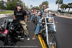 """""""Moonshiner Josh"""" Owens (R) with his dog """"Cutie Pie"""" next to Brad Gregory on his custom 2012 Harley-Davidson Sportster at they ride back from Tamoka State Park during Daytona Beach Bike Week 2015. FL, USA. March 13, 2015.  Photography ©2015 Michael Lichter."""