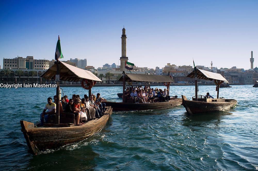 Traditional Abra water ferries crossing The Creek at Deira in Dubai United Arab Emirates