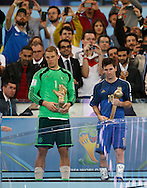 Germany's Manuel Neuer (left) with his Golden Glove award and Argentina's Lionel Messi with his  Golden Ball award during the 2014 FIFA World Cup Final match at Maracana Stadium, Rio de Janeiro<br /> Picture by Andrew Tobin/Focus Images Ltd +44 7710 761829<br /> 13/07/2014