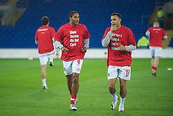 CARDIFF, WALES - Friday, October 8, 2010: Wales' captain Ashley Williams and Hal Robson-Kanu wear 'Show Racism The Red Card' shirts before the UEFA Euro 2012 Qualifying Group G match against Bulgaria at the Cardiff City Stadium. (Pic by David Rawcliffe/Propaganda)