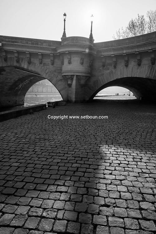 France. Paris. 1st district . the Seine river  under The Pont Neuf On the Quai Conti  connect rive droite and rive gauche / le pont neuf