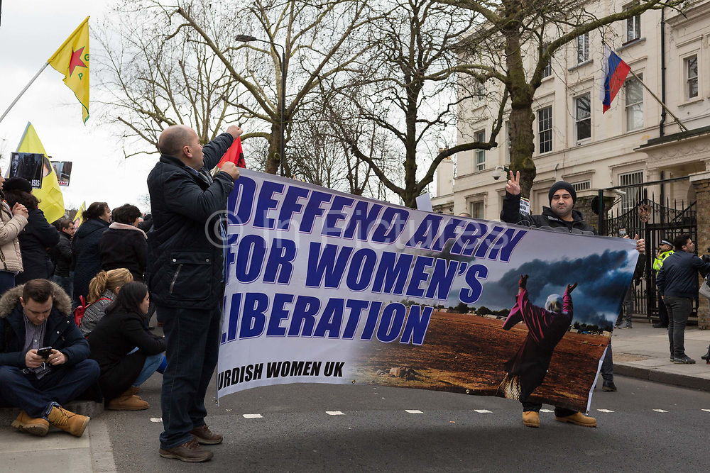 On the day that the British government awaits an explanation from the Kremlin over the poisoning by the nerve gas Novichok in Salisbury of ex-Russian spy Sergei Skripal and his daughter Yulia, an anti-Turkey Kurdish gropup protests outside the Russian Federation Embassy and Consulate Section, on 13th March 2018, in London England.