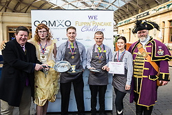 Windsor, UK. 5th March, 2019. Winners of the gold medal in the 13th Windsor and Eton Flippin' Pancake Challenge pose with the Mayor of Windsor and Maidenhead Paul Lion and Official Town Crier of Windsor and Maidenhead Chris Brown after the race on Shrove Tuesday in aid of Alexander Devine Children's Hospice Service and Windsor Homeless Project.