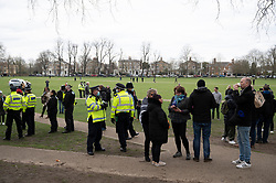© Licensed to London News Pictures. 06/03/2021. London, UK. Police officers disburse protesters attending an anti-vaccination and anti-lockdown demonstration organised by Jam For Freedom in Richmond. The group is using music to create positive effects and health against the current tier regulations and anti-vaccination for the Covid-19 disease. Photo credit: Ray Tang/LNP