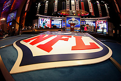 The NFL Logo is seen in the foreground of the Draft stage during the first round of the NFL Draft on April 26th 2012 at Radio City Music Hall in New York, New York. This image was taken with a fisheye lens. (AP Photo/Brian Garfinkel)