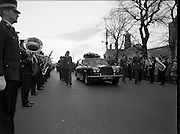 Body of Private Stephen Griffin killed in Lebanon is returned to his home soil..1980-04-19.19th April 1980.19-04-1980.04-19-80..Photographed at Arbor Hill:..Guard of honour from the Ist Field Engineers Company, Cork, colleagues of the late Private Stephen Griffin, acompany the hearse as it arrives at Arbor Hill, Dublin. A military band lines the route.