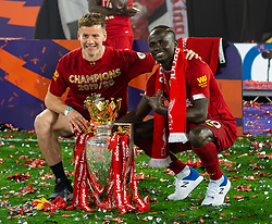LIVERPOOL, ENGLAND - Wednesday, July 22, 2020: Liverpool's Sadio Mané (R) poses with the Premier League trophy and first-team fitness coach Conall Murtagh as the Reds are crowned Champions after the FA Premier League match between Liverpool FC and Chelsea FC at Anfield. The game was played behind closed doors due to the UK government's social distancing laws during the Coronavirus COVID-19 Pandemic. (Pic by David Rawcliffe/Propaganda)