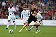 Jack Cork of Swansea city gets in ahead of Kevin de Bruyne of Manchester city. Premier league match, Swansea city v Manchester city at the Liberty Stadium in Swansea, South Wales on Saturday 24th September 2016.<br /> pic by Andrew Orchard, Andrew Orchard sports photography.