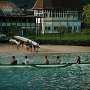 Spirited teams practice their paddling skills in the bay at Pago Pago, Tutuila, American Samoa.