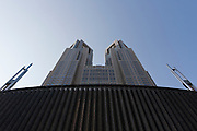 The towers of the Tokyo Metropolitan Government building seen from below. Shinjuku, Tokyo, Japan Saturday November 28th 2009