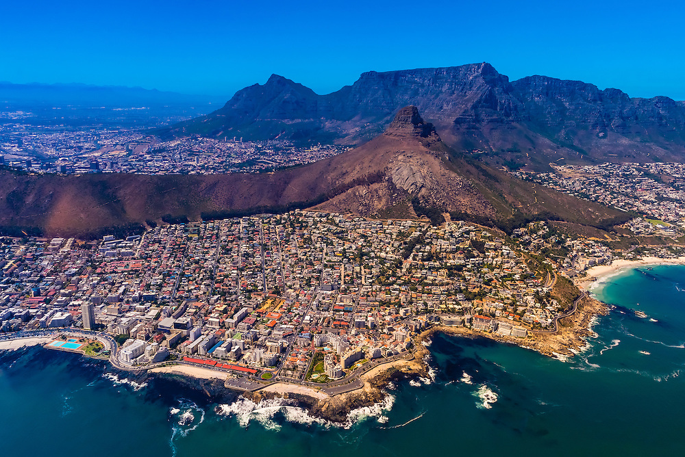 Aerial view of coastline of Cape Town with Lion's Head and Table Mountain in background, South Africa.
