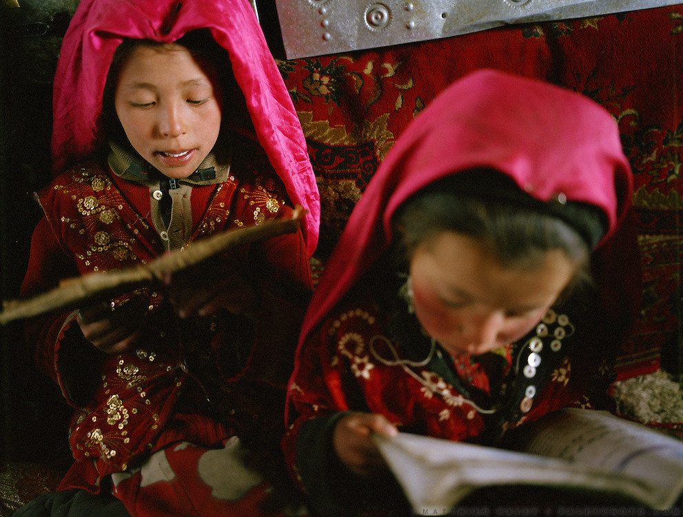 Girl learning to read Koran at Haji Osman:Bibi Hawa (11 yrs old) and Marbet (6) . They start learning at 6 years old. They are taught only in winter 3 months/year..Campment of Tshar Tash (Haji Osman's camp), in the Wakhjir valley, at the source of the Oxus..Winter expedition through the Wakhan Corridor and into the Afghan Pamir mountains, to document the life of the Afghan Kyrgyz tribe. January/February 2008. Afghanistan