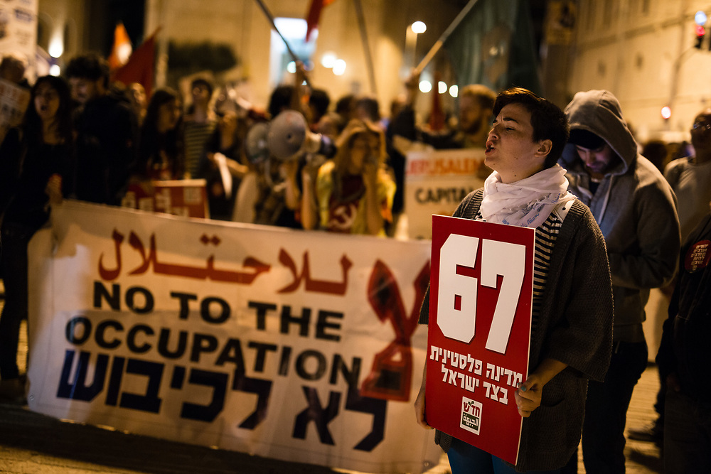 Israeli left-wing activists march during a demonstration marking the 48th anniversary of the 1967 war and calling to end the Israeli occupation, in downtown Jerusalem, on May 30, 2015.