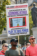"""People hold placards as thousands of protesters from across the UK gathered in London's Trafalgar Square on Saturday, Sept 19, 2020 - afternoon to protest against coronavirus restrictions and reject mass vaccinations. The event, which began at noon, drew a broad coalition including coronavirus sceptics, 5G conspiracy theorists and so-called """"anti-vaxxers"""". Speakers at the event accused the government of attempting to curtail civil liberties. (VXP Photo/ Vudi Xhymshiti)"""