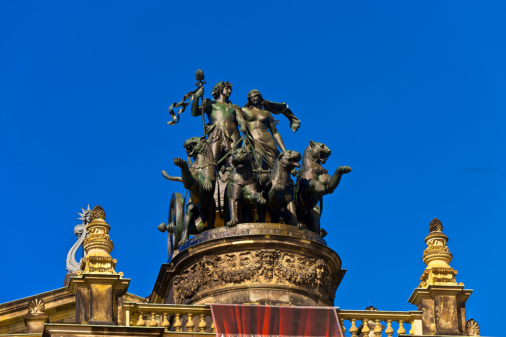 Statue of a panther-drawn quadriga with Dionysos (Greek God of the art) and Ariadne atop the Semper Opera House, Theaterplatz, Dresden, Saxony, Germany