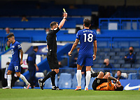 Football - 2019 / 2020 Premier League - Chelsea vs. Wolverhampton Wanderers<br /> <br /> Chelsea's Olivier Giroud is shown a yellow card by Referee Stuart Attwell after his foul on Wolverhampton Wanderers' Ruben Neves, at Stamford Bridge.<br /> <br /> COLORSPORT/ASHLEY WESTERN