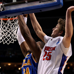 Mar 19, 2011; Tampa, FL, USA; Florida Gators forward Chandler Parsons (25) blocks a dunk attempt by UCLA Bruins center Joshua Smith (34) during second half of the third round of the 2011 NCAA men's basketball tournament at the St. Pete Times Forum. Florida defeated UCLA 73-65.  Mandatory Credit: Derick E. Hingle