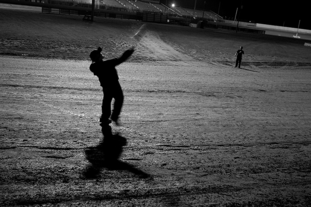 Scott Morgan/The Hawk Eye<br /> Sheldon Brockett, 10, throws a football to  his brother William Brockett, 12, both of Gulfport, Ill. while playing on the track after the races..Friday Aug. 18, 2006 at the 34 Raceway in Middletown, Iowa.
