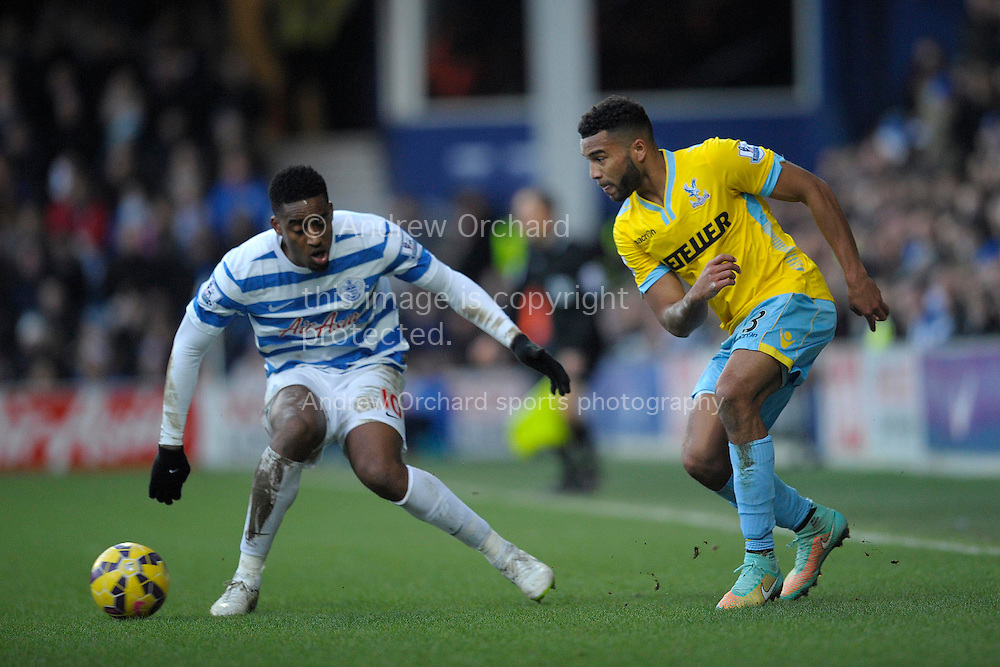 Adrian Mariappa of Crystal Palace passing the ball away from Leroy Fer of QPR. Barclays Premier league match, Queens Park Rangers v Crystal Palace at Loftus Road in London on Sunday 28th December 2014.<br /> pic by John Patrick Fletcher, Andrew Orchard sports photography.