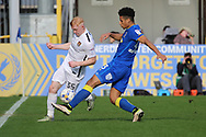 AFC Wimbledon striker Lyle Taylor (33) tackling Northampton Town forward Luke Williams (35) during the EFL Sky Bet League 1 match between AFC Wimbledon and Northampton Town at the Cherry Red Records Stadium, Kingston, England on 11 March 2017. Photo by Matthew Redman.