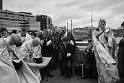 Bishop of Lambeth conducting prayers, wearing cloak made by incorporating flotsam from the river, , The Blessing of the river, St. Magnus the Martyr and Southwark Cathedral join on London Bridge to Bless the river Thames. 13 January 2019