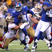 Andre Williams, New York Giants, is tackled by Chris Borland, San Francisco 49ers, during the New York Giants V San Francisco 49ers, NFL American Football match at MetLife Stadium, East Rutherford, NJ, USA. 16th November 2014. Photo Tim Clayton