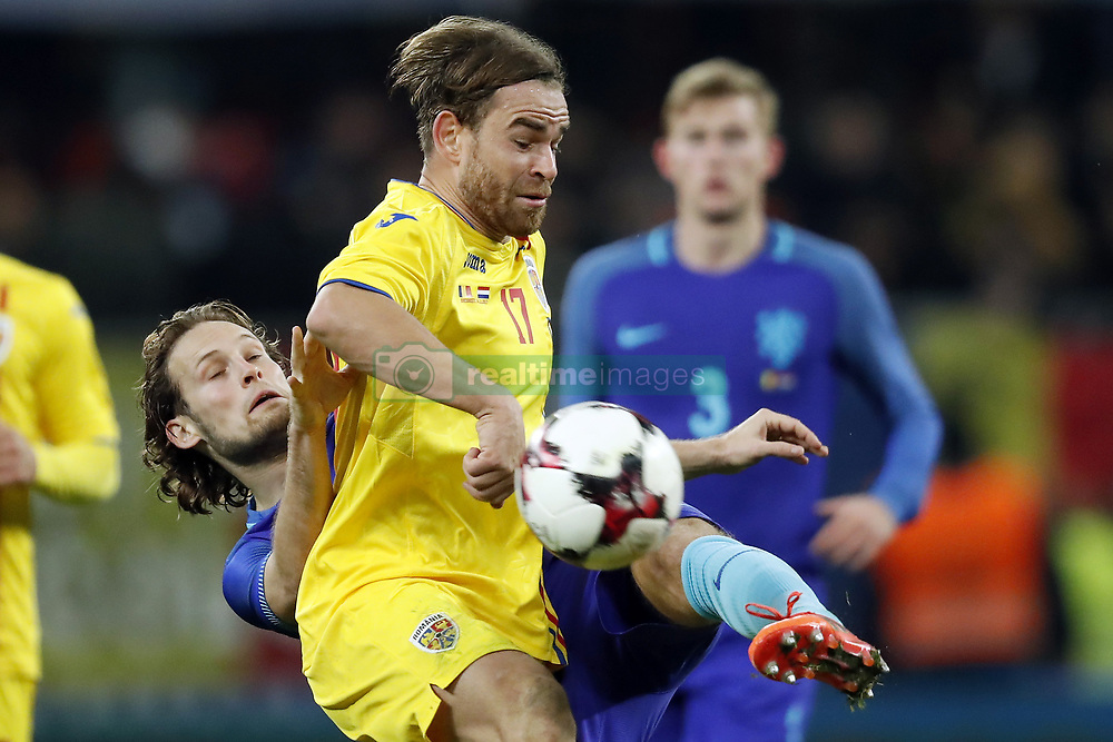 (L-R) Daley Blind of Holland, Eric Bicfalvi of Romania, Matthijs de Ligt of Holland during the friendly match between Romania and The Netherlands on November 14, 2017 at Arena National in Bucharest, Romania