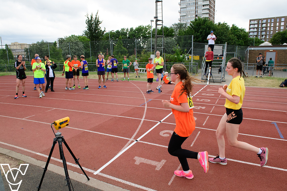 Event: 5000 meter relay<br /> Competitors, from left: Rebecca Blakey<br /> <br /> Metro Blind Sport's 42nd Athletics Open, held at Mile End Stadium, Tower Hamlets, London.<br /> <br /> Picture: Chris Vaughan Photography for Metro Blind Sports<br /> Date: June 16, 2018