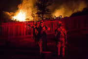 Firefighters talk about their plan to stop the fire. They decided to stop the fire before it comes down to the fence. On Thursday, December 7th, 2017 at Camp Ramah in California in Ojai, California.